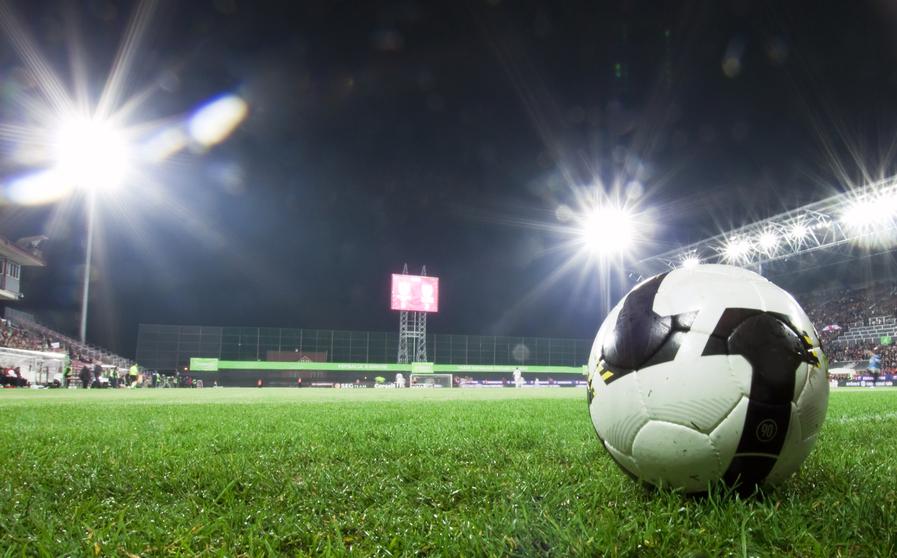 Soccer ball in stadium at night